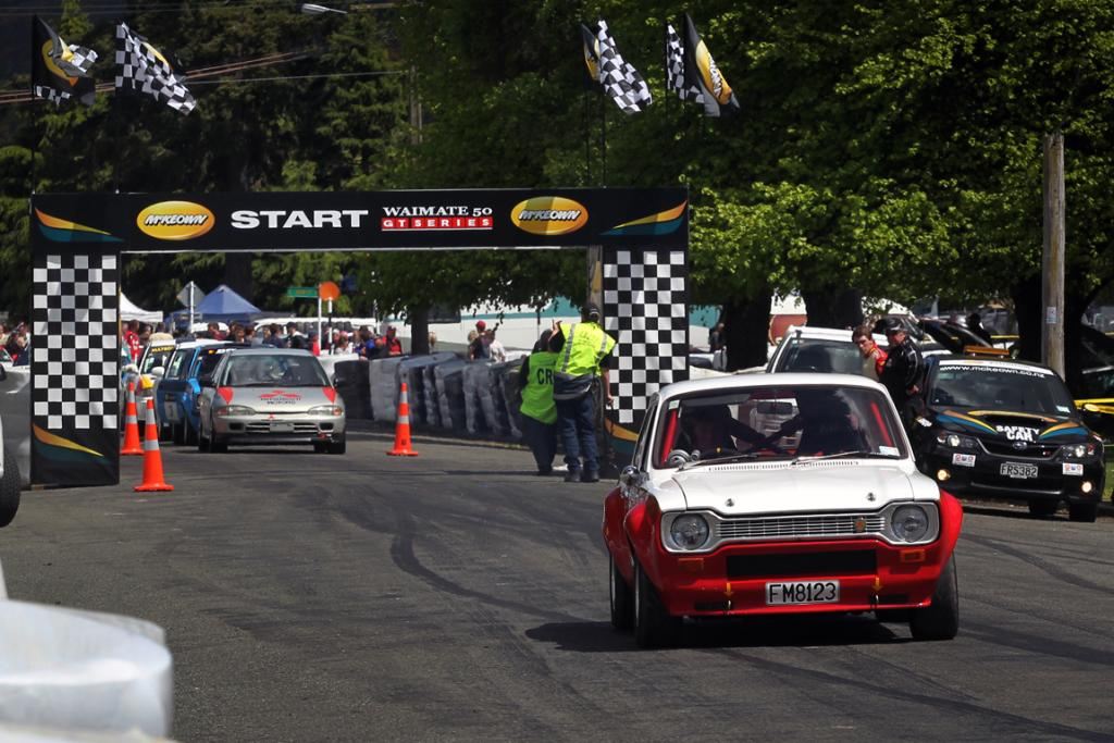 Garry Mechew from Rangiora in his Ford Escort racing in the street sprint at the Waimate 50.