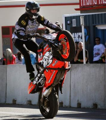 Nic Kroeze from Stunt NZ performing tricks on a motorbike at the Waimate 50.