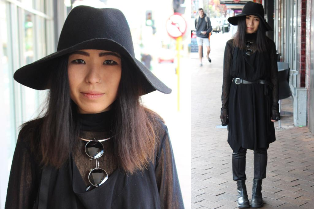 Judith, photographed on George St, Dunedin wears a vintage hat and boots, Nom*d dress and belt and Zambesi pants.