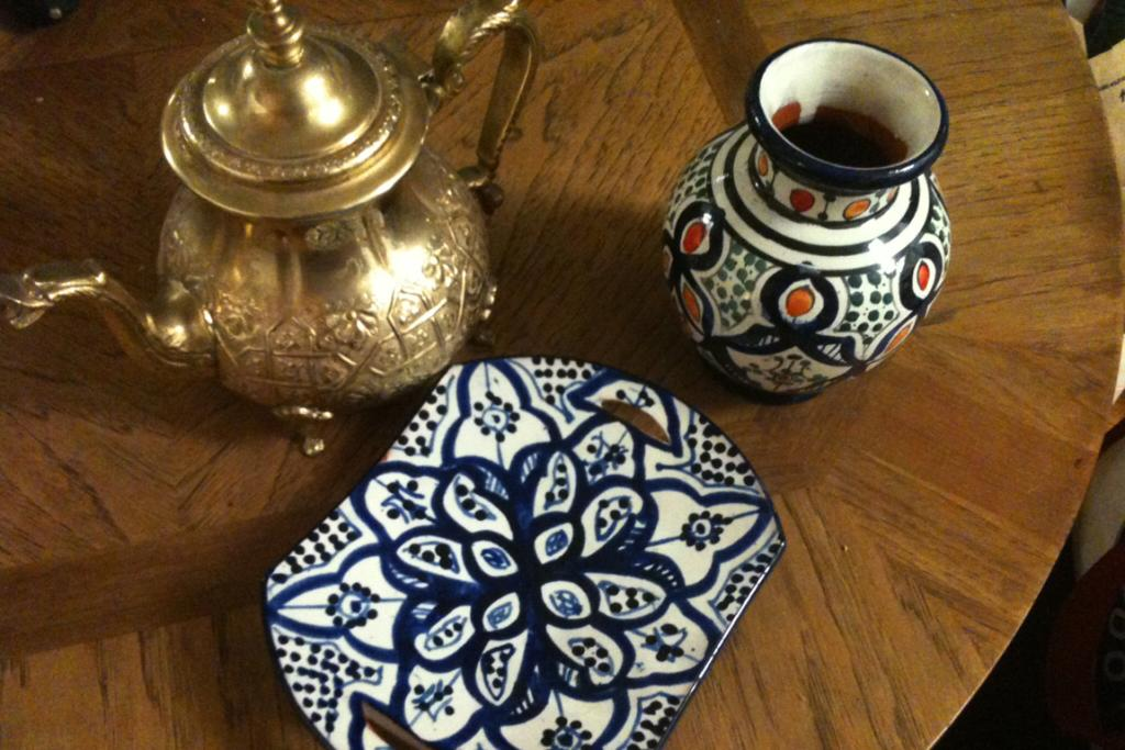 A tea pot, purchased in Essaouira, Morocco, and a ceramic vase and plate, purchased in Marrakech, Morocco, by Maura Judkis and Scott Gilmore.