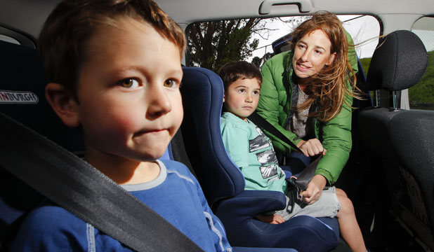 BUCKLING UP: Dierdre Johnstone has another two years of strapping in her son, Thane, and friend Max Broadbridge, left, both 5, with child restraints under new rules from today.
