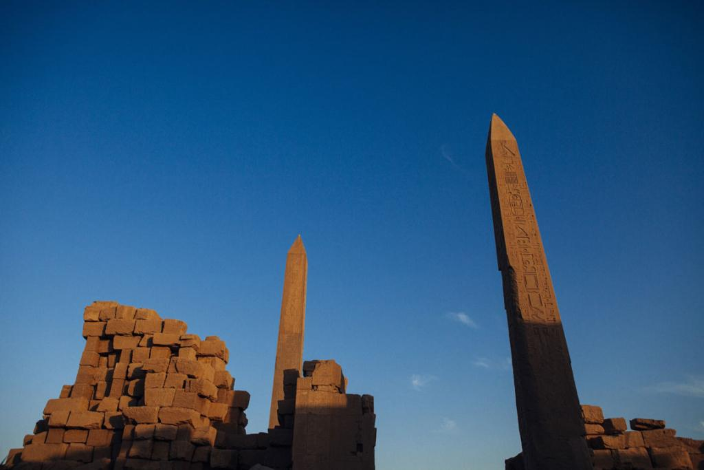 The Karnak Temple is lit by the day's last light in Luxor, Egypt.