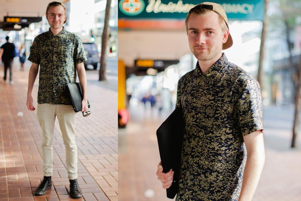 Harry, seen on Willis St in Wellington, wears a YMC (You Must Create) shirt, Huffer pants, Converse shoes and a Norse Projects cap.