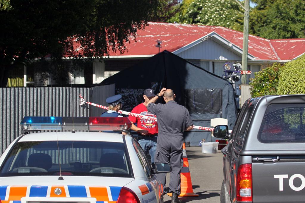 INVESTIGATING: Police attend a suspected murder scene in Momorangi Crescent in Redwood.