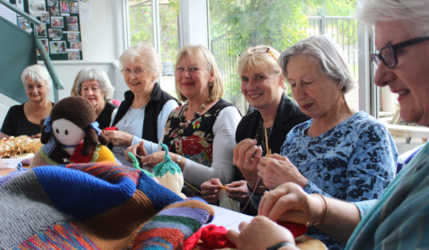 SEWN TOGETHER: Adair Eady, third from right, with the Devonport Peggy Purl in your Community knitting group. She is the daughter of Peggy Cook, which peggy squares are named after.