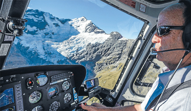 Queenstown pilot Alfie Speight, where he is happiest, in the air.