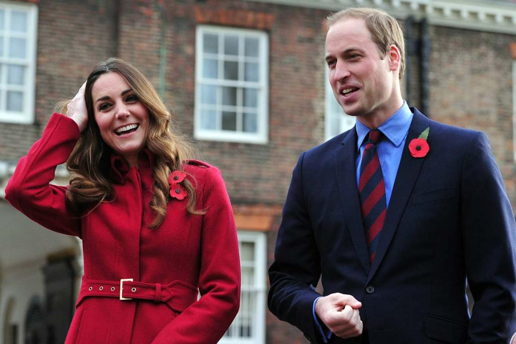 Kate and Wills arrive to meet volunteers and workers during a Royal British Legion Poppy Day event at Kensington Palace, London.