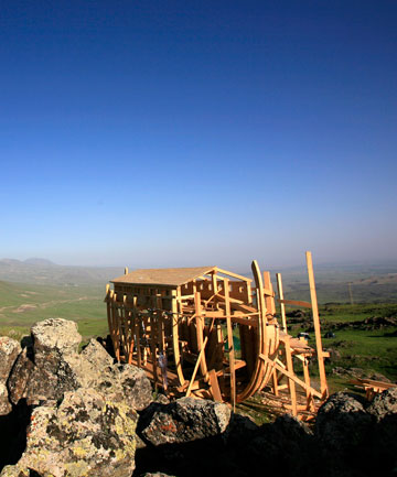 NOAH'S ARK: The modern day version of the legendary Noah's Ark built by Greenpeace volunteers from Turkey and Germany rests on Mount Ararat at dawn.