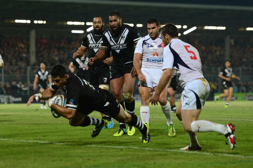 Bryson Goodwin dives over for a try in the Kiwis' 48-0 rout of France.
