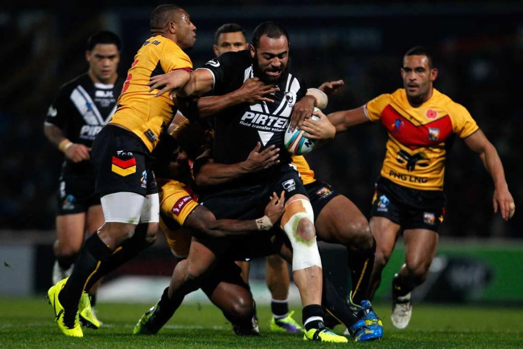 Sam Kasiano barrels through the Papua New Guinean defence during the Kiwis' 56-10 rout.