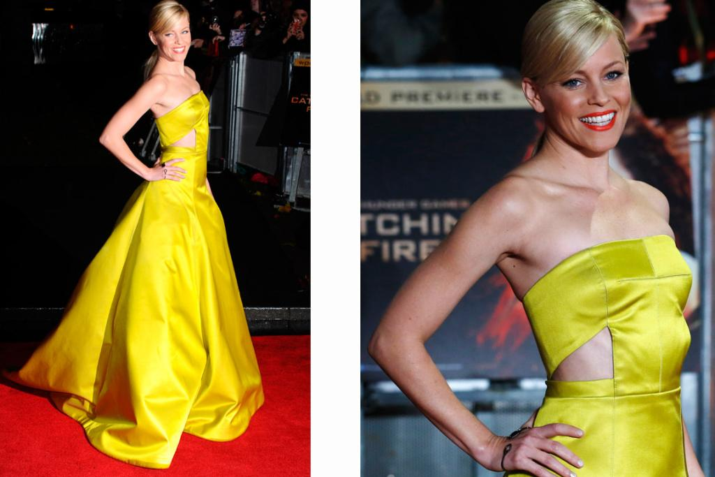 ELIZABETH BANKS: She plays the extravagantly-dressed Effie Trinket in the movie, and so it's apt that the star has gone bold for the red carpet. She easily upstages Jennifer Lawrence in this yellow Jason Wu gown. While the fit up-top was a little awkward, overall this look is dazzling.