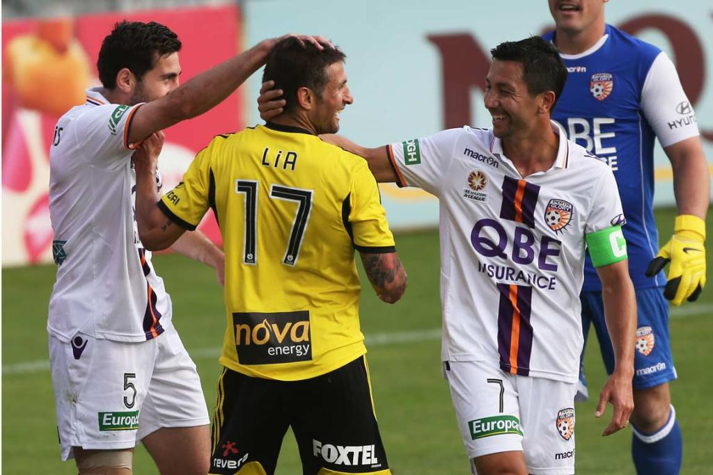 Phoenix midfielder Vince Lia gets mocked by Perth's Steve Pantelides and Jacob Burns.