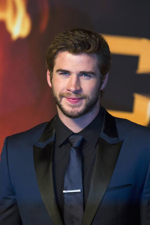 Liam Hemsworth poses on the red carpet before the German premiere of The Hunger Games: Catching Fire in Berlin.