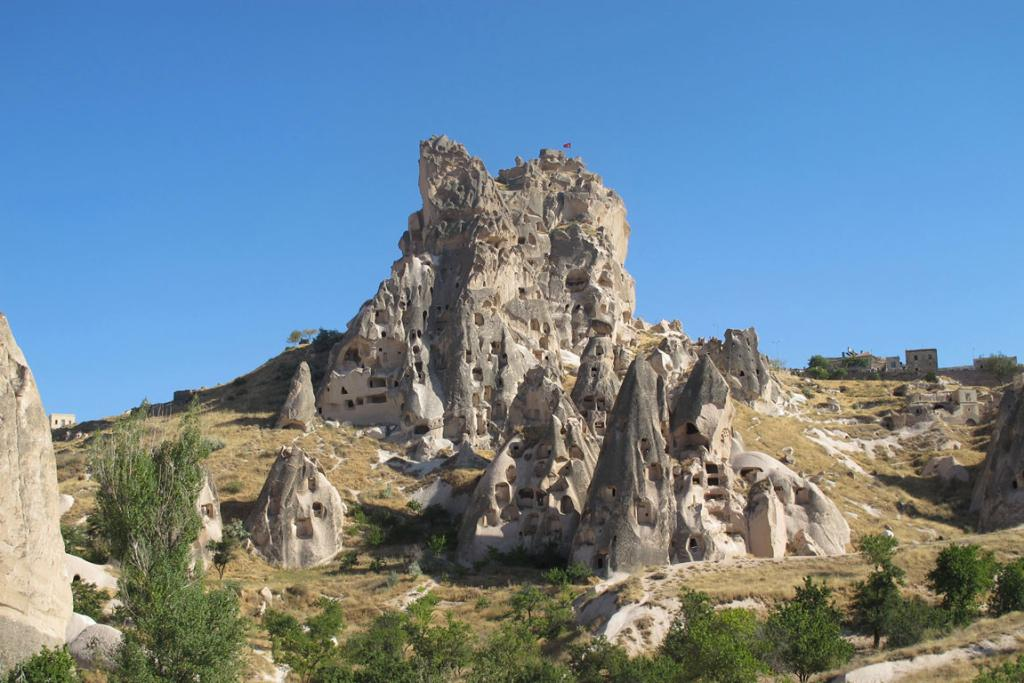 "The Uchisar Rock Castle is the highest point in Turkey's desertlike-region of Cappadocia; the region is dotted with mysterious ""fairy chimneys"" formed from volcanic rock hewn over the centuries into jutting towers."