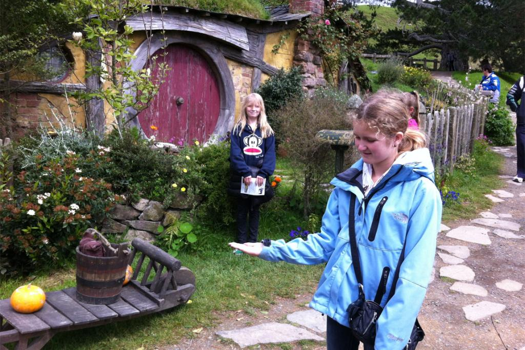 Holly Smallwood holding a Hobbit (Bayley Smallwood) on her hand at Hobbiton, Matamata, Middle Earth, New Zealand. Awesome tour that really sparks your imagination!