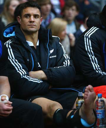 FEELING THE STRAIN: Dan Carter sits on the All Blacks bench with ice on his right Achilles after limping off in the first half of his 100th test against England.
