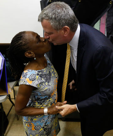Then-candidate Bill de Blasio gets a kiss from his wife, Chirlane McCray, after voting in the Democratic primary in September.