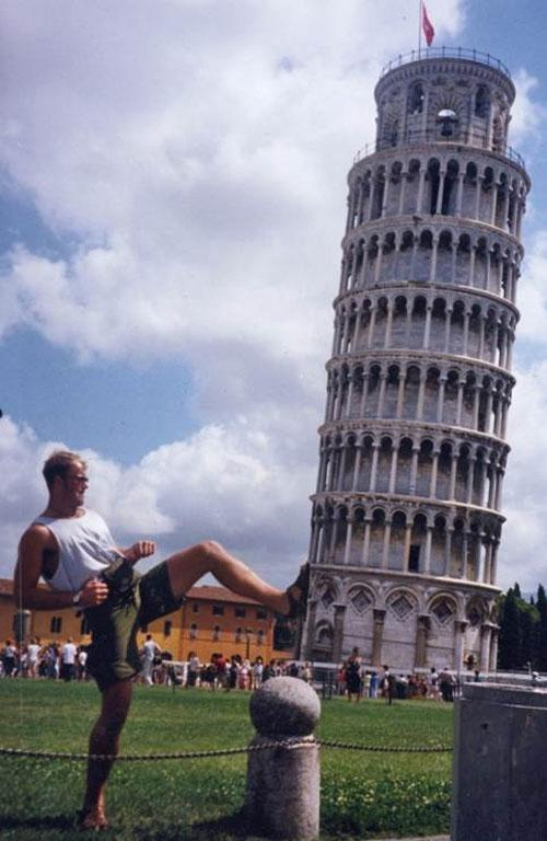 A variation on a cliche! A few years ago, my brother and I were in Italy to meet relatives for the first time. We had to visit Pisa and were amused by all the silly-looking people with their hand in the air trying to hold it up, so we couldn't resist our own version - kicking it down!! This photo was taken with an 'old-school' 35mm Olympus camera.