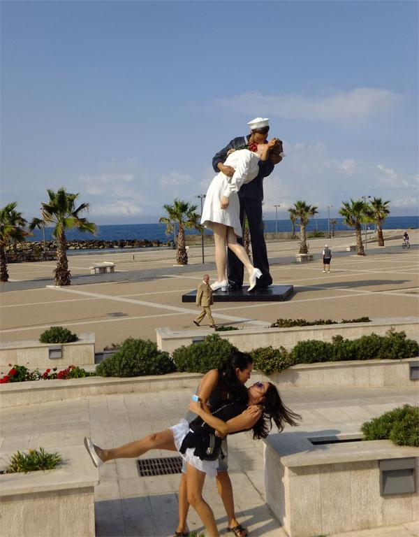 In Civitavecchia, Rome, Italy, we came across this iconic statue, and well it didn't take long until I was swept off my feet by my friend Olena. Taken on the 28th of June 2013, by our friend Tanya.