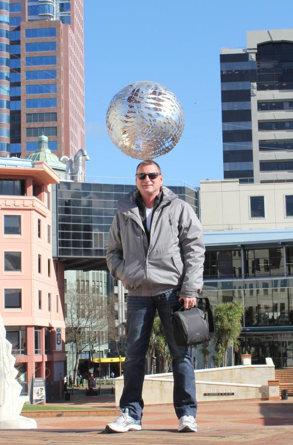 Phil Clements balancing the silver fern ball in Wellington's Civic Square. Photo taken by Karen Clements.