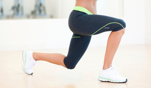 FEEL THE BURN: Make ordinary lunges harder by elevating your back leg.