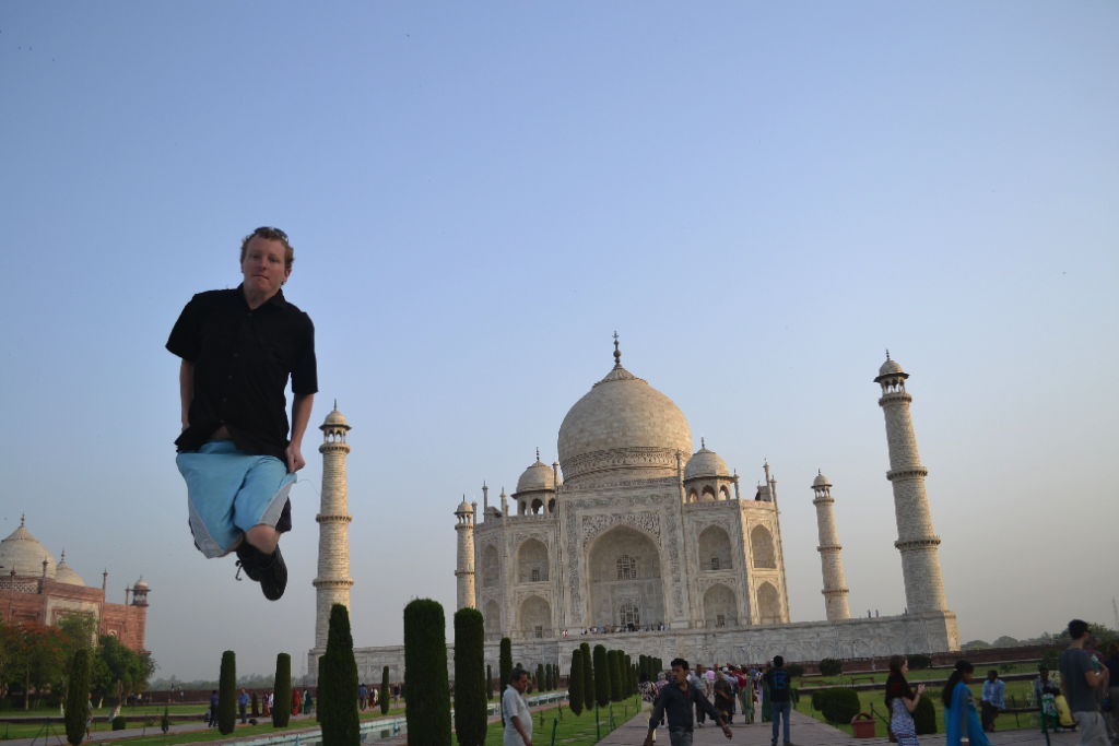 Me attempting a cliched jumping photo in front of the Taj Mahal.