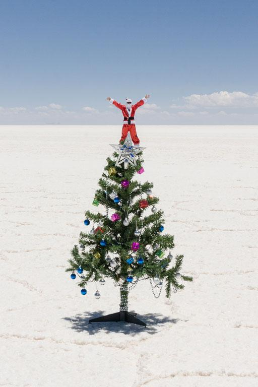 Our driver as Santa Claus on top of the Christmas tree in Salar Uyuni, Bolivia.