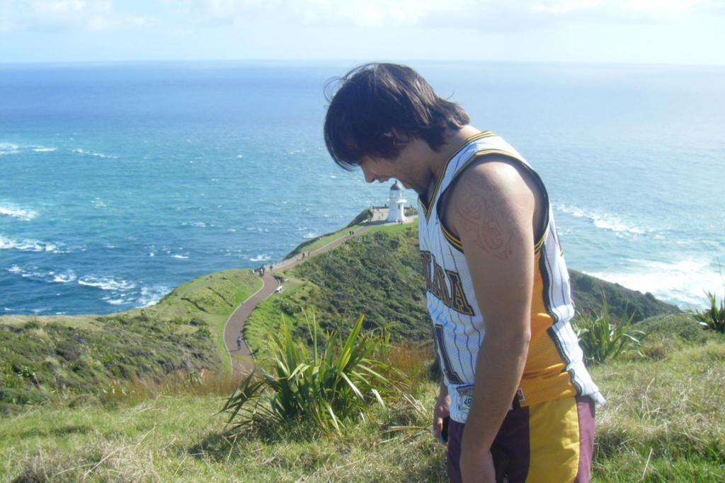Jess Malcolm's partner Matt taking a bite out of the lighthouse at Cape Reinga.