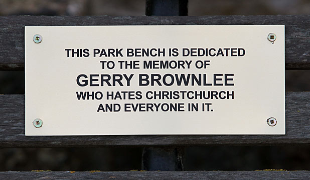 DEDICATED: A mystery plaque has been nailed to a park bench.