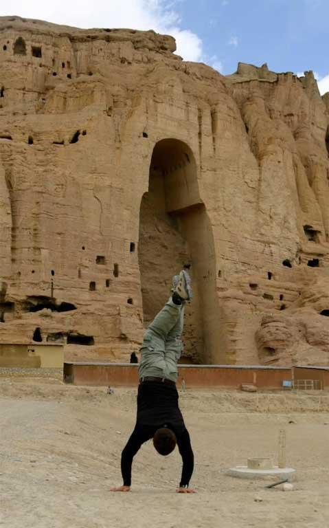 Jared Mason attempts an ancient handstand, in Bamyan, Afghanistan.