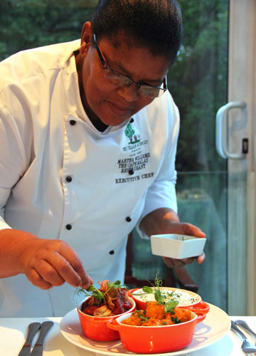 COLOURFUL CUISINE: In Cape Town, South Africa, executive chef Martha Williams elevates the tomato bredie to a form of fine dining at Cellars-Hohenort, where she teaches guests about the nuances of Cape Malay food.