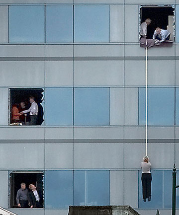 QUAKE ESCAPE: Collapsed stairwells forced office workers to escape Forsyth Barr by rope after the February 2011 quake.