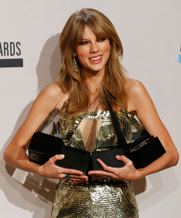 SWEET SUCCESS: Taylor Swift poses backstage with her four awards from the 41st American Music Awards.