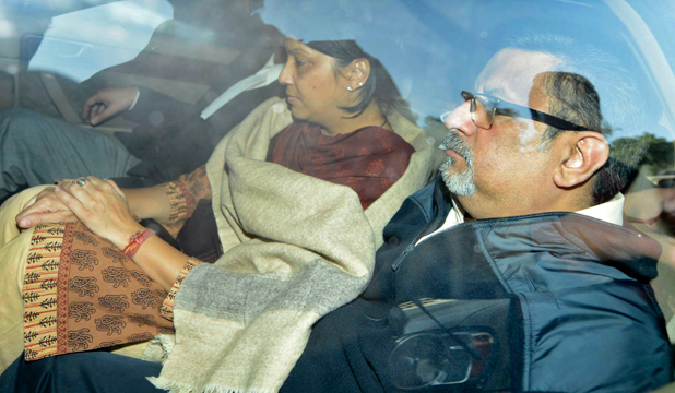 GUILTY: Rajesh and Nupur Talwar are taken to court in Ghaziabad, on the outskirts of New Delhi.