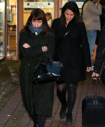 ACCUSED: Elisabetta and Francesca Grillo leave Isleworth Crown Court after the hearing for their fraud charges.