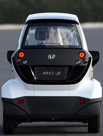 This rear view illustrates the narrow width of the diminutive MC-B.