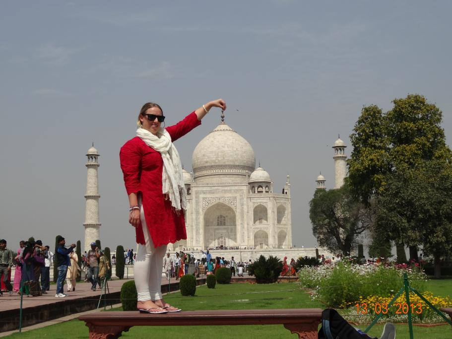 Tracey 'touching' the top of the Taj Mahal in Agra, India in March 2013. A very hot day, well over 30 degrees.