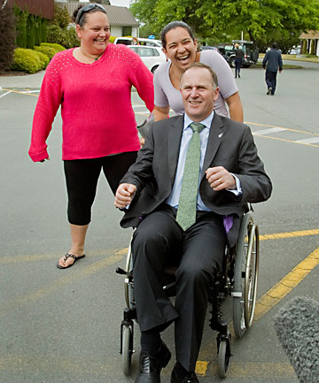 John Key in wheelchair