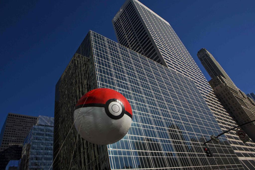 A Pokeball balloon floats down Sixth Avenue during the 87th Macy's Thanksgiving Day Parade in New York.