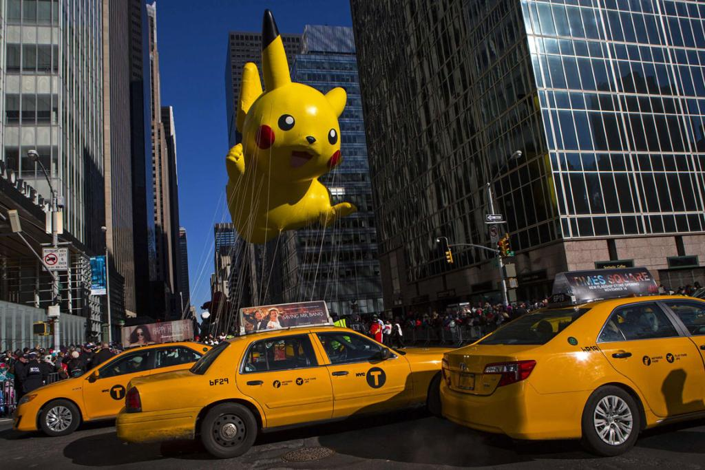 A Pikachu balloon floats down Sixth Avenue during the 87th Macy's Thanksgiving Day Parade in New York.