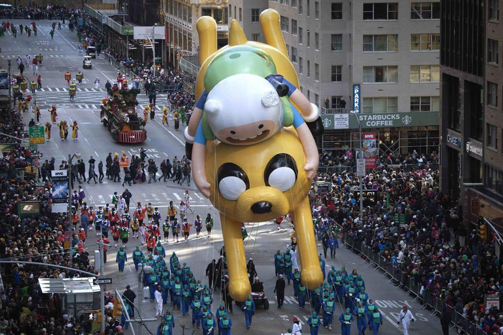 A float of Finn and Jake from Adventure Time makes its way down Sixth Avenue during the 87th Macy's Thanksgiving Day Parade in New York.