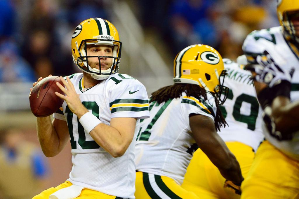 Green Bay Packers quarterback Matt Flynn looks to pass during the first quarter of a NFL football game against the Detroit Lions on Thanksgiving.