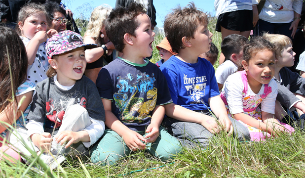 Bluff School pupils, from left, Sailor Hawkless, Lucan Akuhata, Paul Carter and Larnee-Jay Batchelor, all 5, get time off school to watch a heat of the Bluff Hill Climb Champs