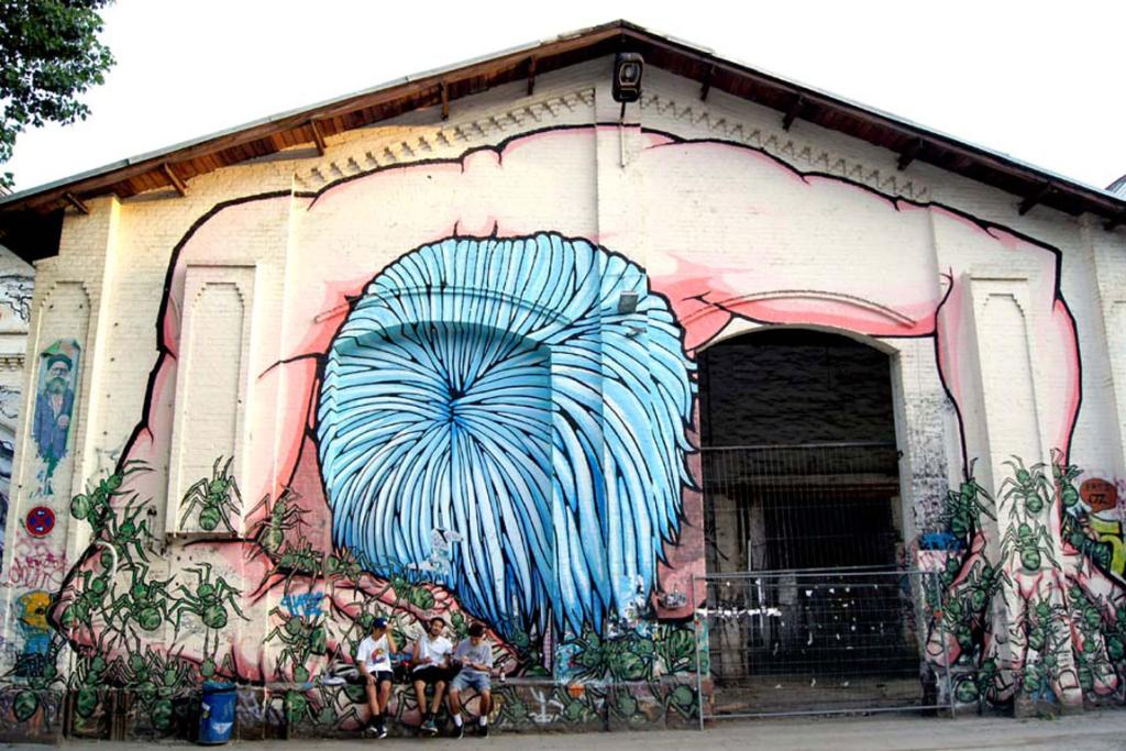 Huge works of arts on walls in Berlin often incorporate elements of the buildings they are painted on.