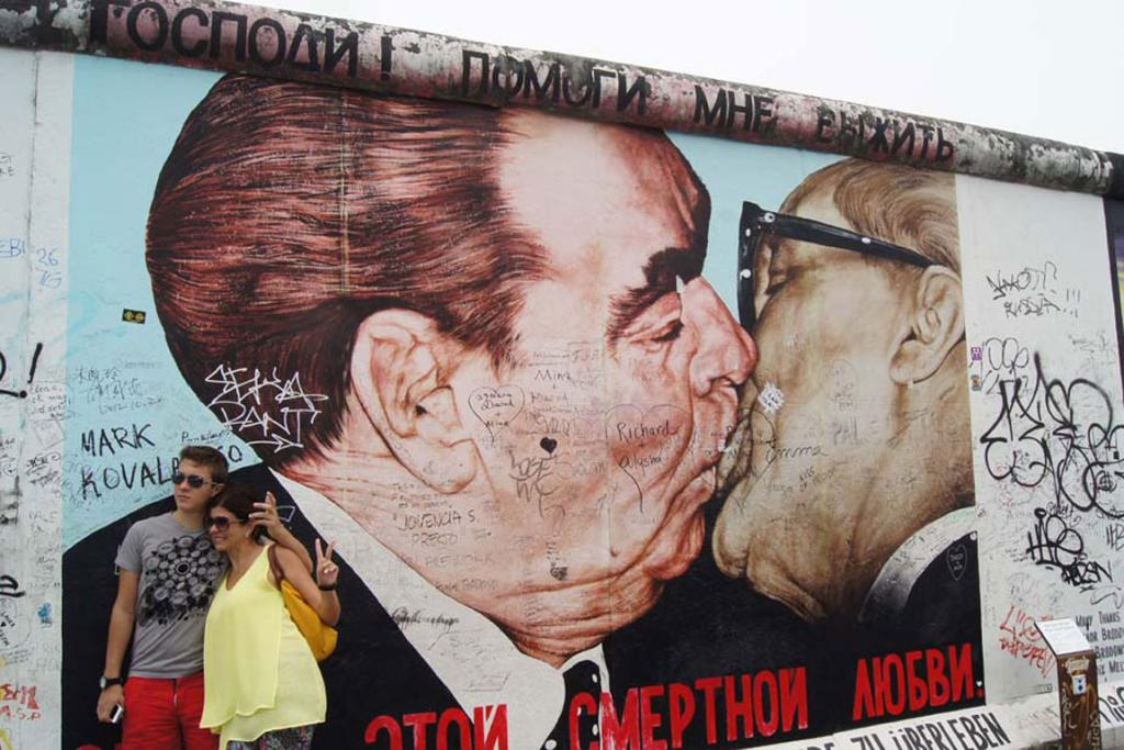 The famous kiss painting on the East Side Gallery is one of the most popular works on the Berlin Wall. It features East German leader Erich Honecker and Soviet leader Lenoid Brezhnev.