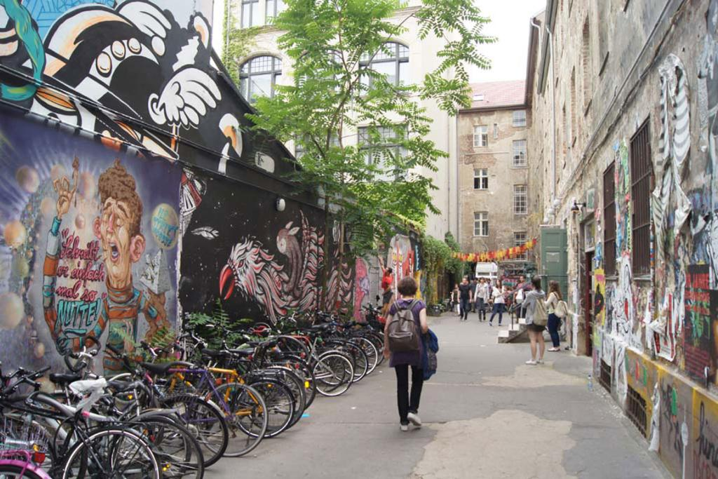 The lane behind the building at 39 Rosenthaler Strasse is filled with street art.