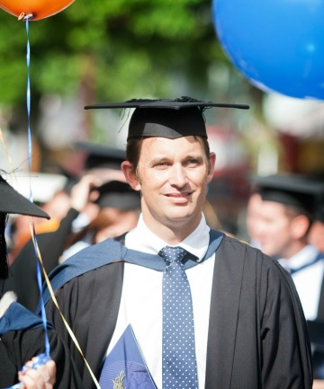 BLACK CAPPED: Former New Zealand fast bowler Shane Bond graduated from Massey University yesterday.