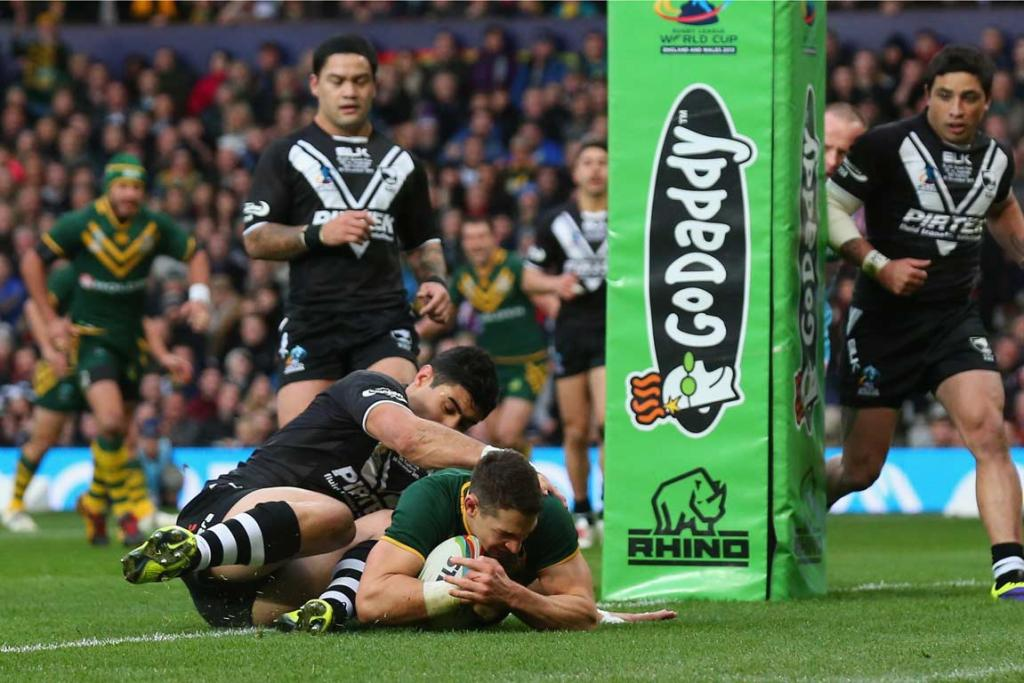 Billy Slater scores the first try of the final in the tackle of Dean Whare.