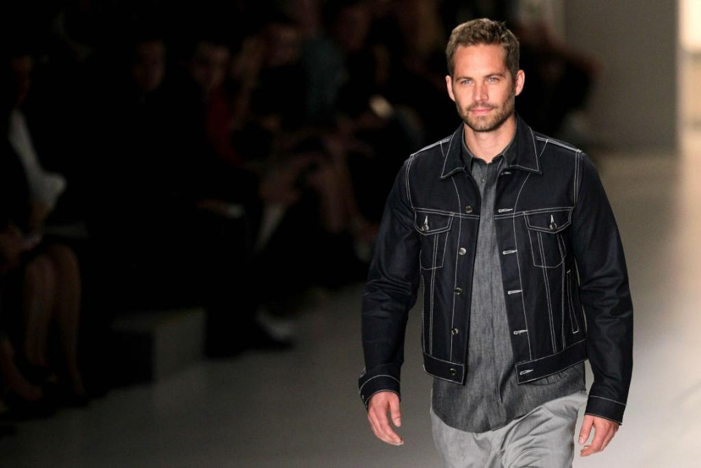 SHARPLY DRESSED: US actor Paul Walker on the catwalk during Sao Paulo Fashion Week in March 2013.