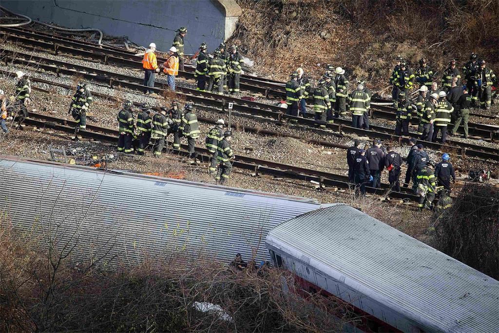 Emergency workers gather at the site of a Metro-North train derailment.